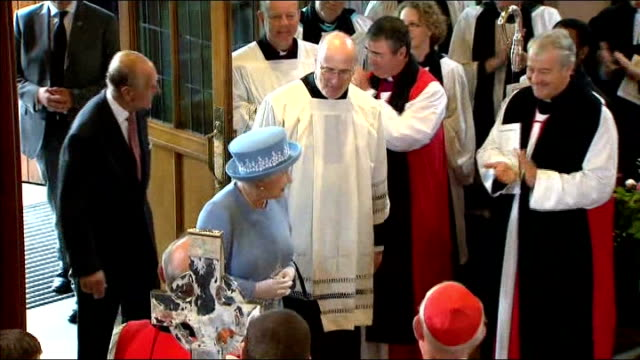 queen visits enniskillen on diamond jubilee tour; int queen and prince philip into church to applause queen smiling as meets people and choir sings... - choir stock videos & royalty-free footage