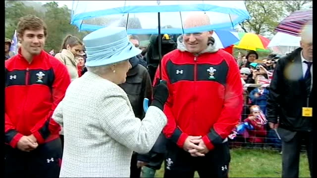 queen visits glanusk park's diamonds in the park festival ext queen chatting to firefighters / queen getting into car / queen getting out of car and... - powys stock videos & royalty-free footage