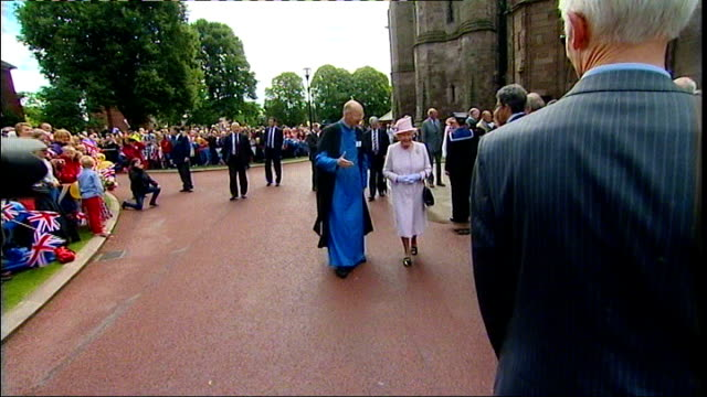 queen visits herefordshire; ext queen arriving at worcester cathedral and choir singing outside sot / queen meeting lineup outside cathedral / queen... - herefordshire stock videos & royalty-free footage