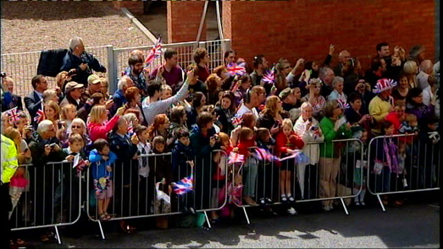 queen visits herefordshire; police motorcycle convoy / royal car leaving through crowd lined street / gvs crowd with union jack flags seen behind... - herefordshire stock videos & royalty-free footage