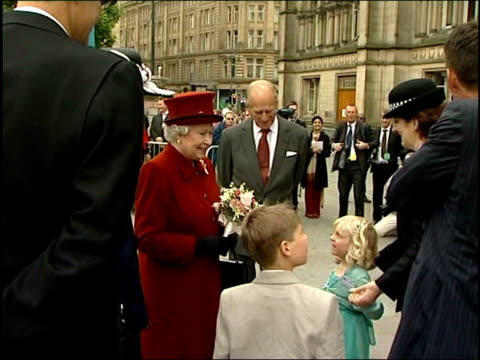 queen visits hindu temple and bradford police headquarters murdered pc sharon beshenivsky's husband daughter meet queen prince philip/ queen and... - pc sharon beshenivsky stock videos & royalty-free footage