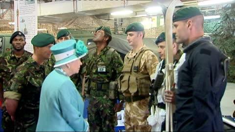 vídeos y material grabado en eventos de stock de queen visits hms ocean at devonport; int queen and prince philip, duke of edinburgh, boarding ship hms ocean / queen chatting to royal marines /... - royal marines