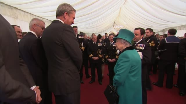 queen visits hms sutherland; england: east london; millwall: ext bow of naval ship hms sutherland decorated with bunting / commander andrew canale... - responsibility stock videos & royalty-free footage