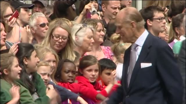 queen visits leeds on diamond jubilee tour england leeds briggate shopping area ext car arriving at briggate shopping area / queen and prince philip... - prince philip stock videos & royalty-free footage