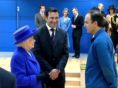 queen visits national tennis centre int cu of queen gv's meeting more people ppeople gathered along balcony watching the queen below queen sits down... - book signing stock videos & royalty-free footage