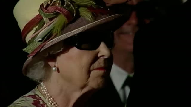 queen visits pinewood studios in toronto close up of queen elizabeth wearing 3d glasses watching movie pull out - 3d glasses stock videos & royalty-free footage