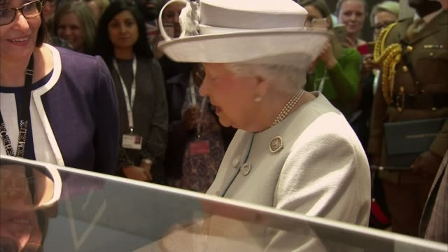 Queen visits Royal College of Physicians to mark 500th anniversary **Wood interview overlaid SOT** Queen Elizabeth II looking at museum display
