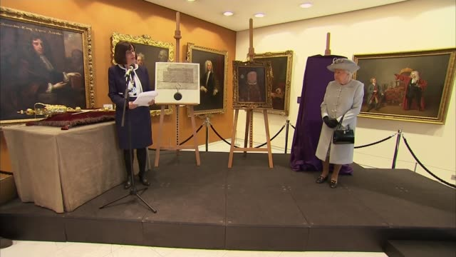 Queen visits Royal College of Physicians to mark 500th anniversary Queen Elizabeth II in front of covered easle Queen on stage as Professor Jane...