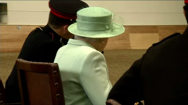 queen visits the kings troop royal horse artillery at woolwich barracks queen into indoor arena and takes her seat and watches gun carriages being... - royal horse artillery stock videos and b-roll footage