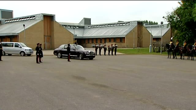 queen visits the kings troop royal horse artillery at woolwich barracks arrival england london woolwich barracks ext buglers fanfare as queen's car... - guard of honour stock videos and b-roll footage