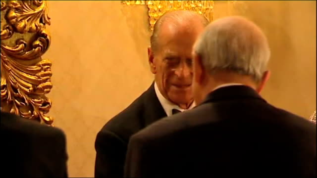 queen visits tomb of mustafa kamal ataturk and attends state banquet; philip coughing as greeting guests / more of guests being greeted / guests... - state dinner stock videos & royalty-free footage