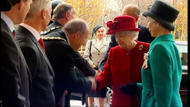 queen visits vodafone headquarters england berkshire newbury ext royal flag being raised / queen elizabeth ii departing car and shaking hands with... - newbury england stock videos & royalty-free footage