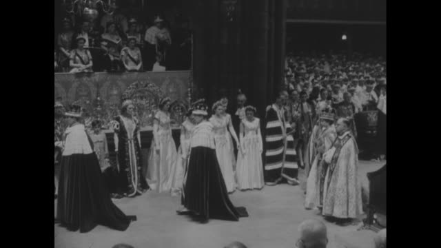 queen wearing crown holding scepter in one hand rod in other walks past king edwardõs chair past maids of honor who curtsy / queen continues walking... - princess margaret 1950 stock videos and b-roll footage
