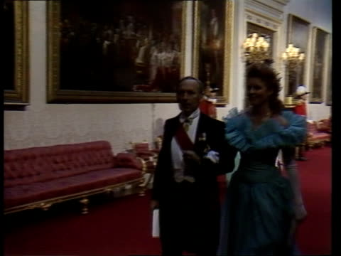 Queen with West German President Weizsacker ITN ENGLAND London Buckingham Palace Sarah Ferguson into banquet Sarah waiting with other guests