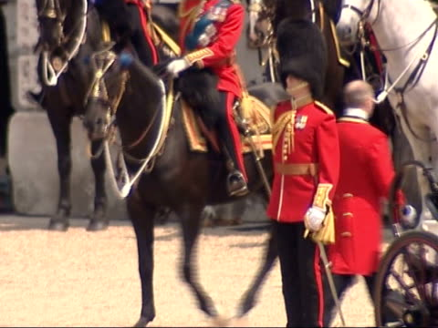 queen's 80th birthday celebrations: trooping the colour: departure from horse guards / royal family watching raf fly-past; england: london: horse... - 軍旗分列行進式点の映像素材/bロール
