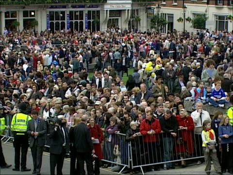 queen's 80th birthday crowds gather at windsor castle / queen's walkabout **following seq has guards band music overlaid sot** more of wellwishers... - windsor england stock videos and b-roll footage