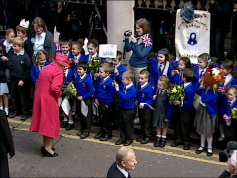 queen's 80th birthday: crowds gather at windsor castle / queen's walkabout; irish guards band playing as marching up and down outside castle sot /... - british royalty stock videos & royalty-free footage