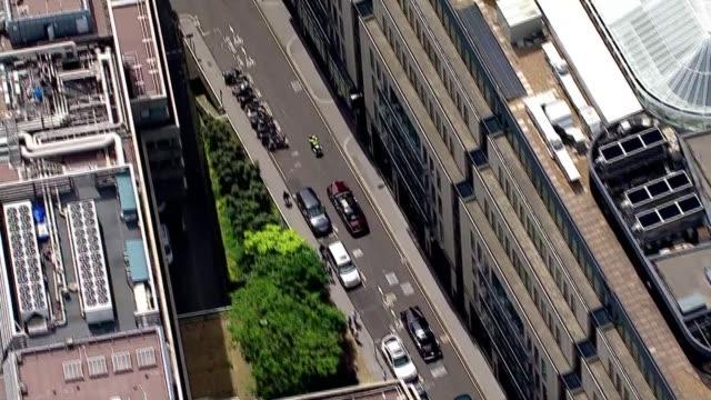 queen's 90th birthday: air views gun salute and royal journey; air views queen's car travelling through london - 90th birthday stock videos & royalty-free footage