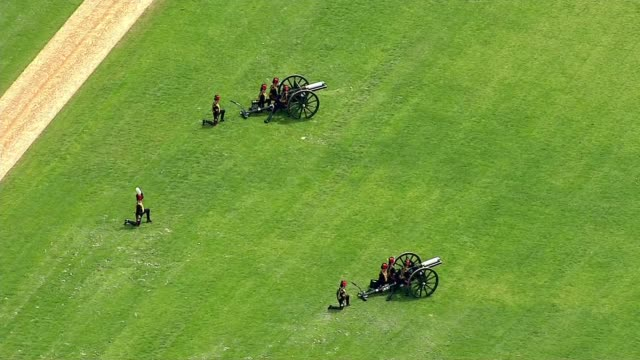 queen's 90th birthday: air views gun salute and royal journey; air views gun salute in hyde park - 90th birthday stock videos & royalty-free footage