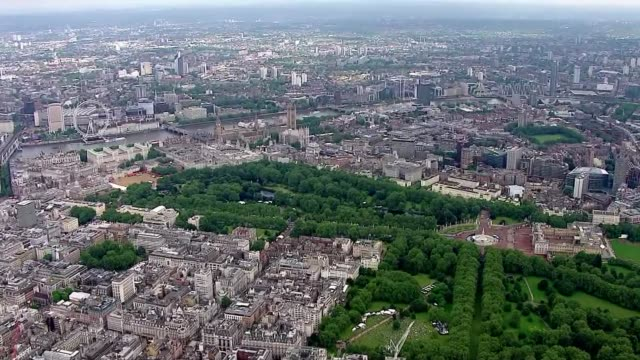 queen's 90th birthday: patron's lunch - air views of the mall; air views / aerials of buckingham palace and the mall patron's l:unch parade - 90th birthday stock videos & royalty-free footage