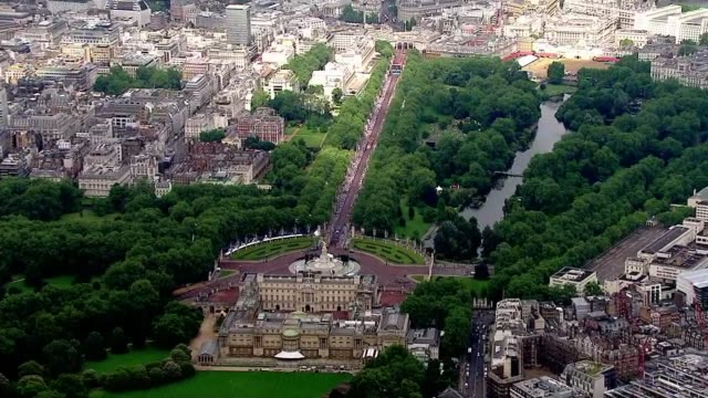 queen's 90th birthday patron's lunch air views of the mall england london views / aerials of buckingham palace and the mall and the parade held as... - 90th birthday stock videos and b-roll footage
