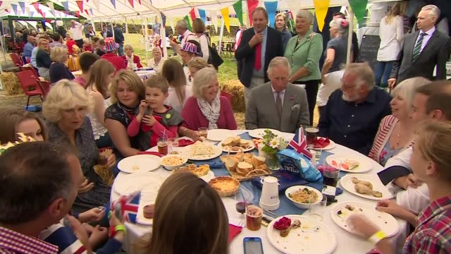 queen's 90th birthday: patron's lunch; gloucestershire: prince charles and camilla, duchess of cornwall attending party camilla chatting to guests - 90th birthday stock videos & royalty-free footage