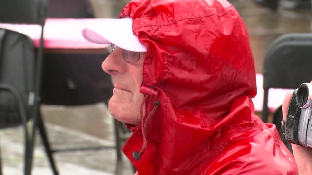queen's 90th birthday patron's lunch trafalgar square various shots people waving union jack flags out men drinking pimms from plastic cups under... - itv london tonight weekend点の映像素材/bロール