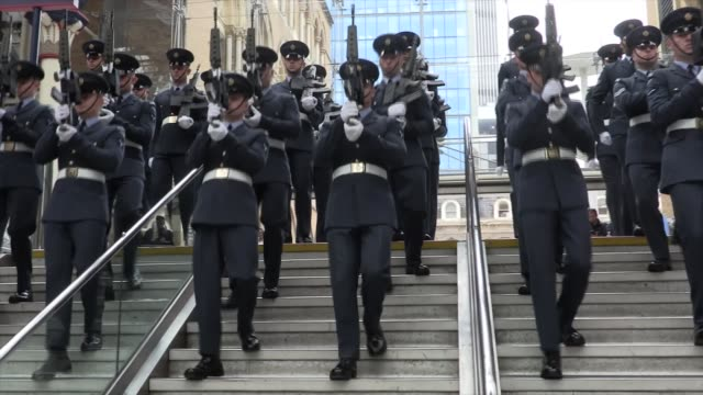 queen's 90th birthday: service of national thanksgiving held; various shots royal air force queen's colour squadron marching drill in station - 90th birthday stock videos & royalty-free footage