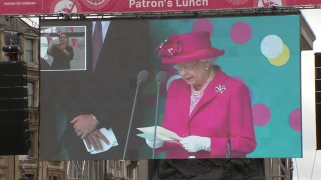 queen's 90th birthday: trafalgar square; england: london: trafalgar square: ext various of people at event in trafalgar square and watching the... - 90th birthday stock videos & royalty-free footage
