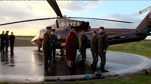 queen's arrival at raf holbeach remote detonation of charge and tour of raf marham queen along with military officer to meet air force personnel on... - hubschrauber landeplatz stock-videos und b-roll-filmmaterial
