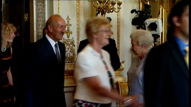 queen's awards for enterprise: reception at buckingham palace; england: london: buckingham palace: int side shot queen elizabeth ii and prince... - vince cable stock videos & royalty-free footage