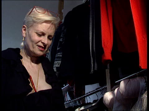 queen's birthday honours itn london vivienne westwood looking at clothes cms vivienne westwood intvwd sof people are impressed by it/it is also an... - westwood stock-videos und b-roll-filmmaterial