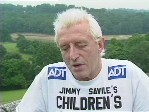 queen's birthday honours list 1990; ext sir james savile intvwd; - itv news at one stock videos & royalty-free footage