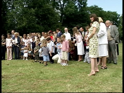 queens birthday honours list; itn england: ext cms tv chef jamie oliver posing for photocall with children at family christening cms photographer... - jamie oliver stock videos & royalty-free footage