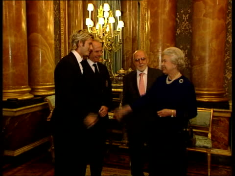 queens birthday honours list; lib england: london: buckingham palace: int side beckham, standing with england manager sven goran eriksson, shaking... - queen's birthday stock videos & royalty-free footage