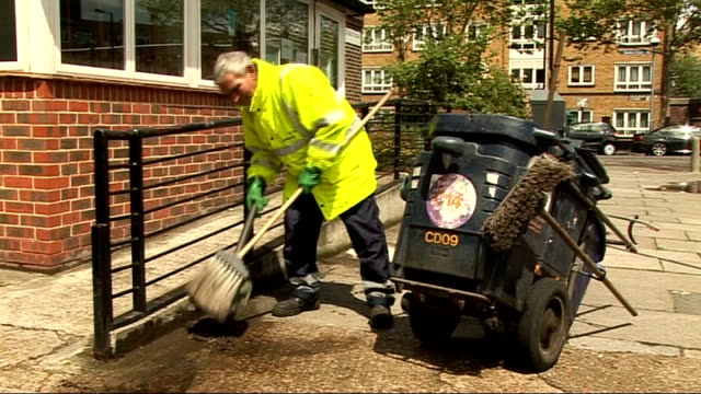 queen's birthday honours list recipients announced lambeth ext street sweeper anthony clelland awarded the british empire medal in the queen's... - lambeth stock-videos und b-roll-filmmaterial