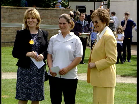 queen's birthday honours trevor mcdonald knighted itn dame norma major standing talking with others balloonist brian jones obe from plane waving... - ノーマ メジャー点の映像素材/bロール