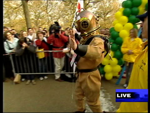 vídeos de stock, filmes e b-roll de queen's birthday list file / 29903 lloyd scott dressed in diving suit as walking along road / wading out of loch ness clean feed tape = d0600555 or... - loch