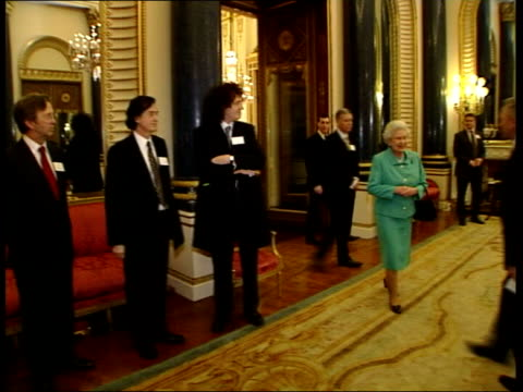Queen's Birthday List FILE / TX Guitarist Brian May at recpetion to honour the British music industry as Queen Elizabeth II enters room and shakes...