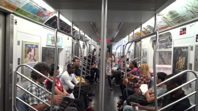 queens bound 7 train / the new hudson yards subway 1.5 mile extension of the 7 line to 34 street and 11 avenue. hudson yards is the only train south... - high street stock-videos und b-roll-filmmaterial