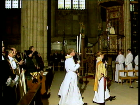 queen's christmas message/ carey/ pope; kent: canterbury cathedral: clerics processing along cms archbishop of canterbury dr george carey sermon - canterbury cathedral stock videos & royalty-free footage