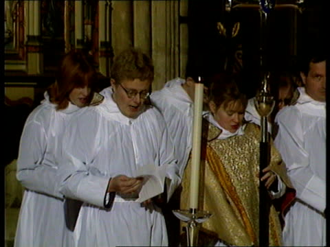 queen's christmas message/ carey/ pope; kent: canterbury cathedral: archbishop of canterbury dr george carey processing along, choir singing, cross... - choir stock videos & royalty-free footage