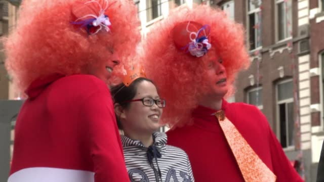 Queen's Day in the Netherlands isn't just about kings and queens it's also a time to revel in Dutch tradition including the colour orange beer and...