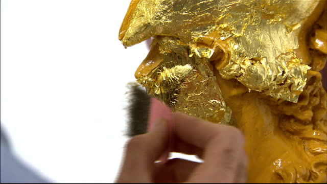 queen's diamond jubilee craft people working on the royal barge england london city guilds of london art school int general views of craftspeople... - gold leaf stock videos & royalty-free footage