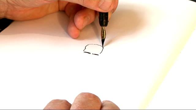 stockvideo's en b-roll-footage met queen's diamond jubilee guardian cartoonist steve bell england london int guardian cartoonist steve bell drawing cartoon of queen as describes her... - cartoonist