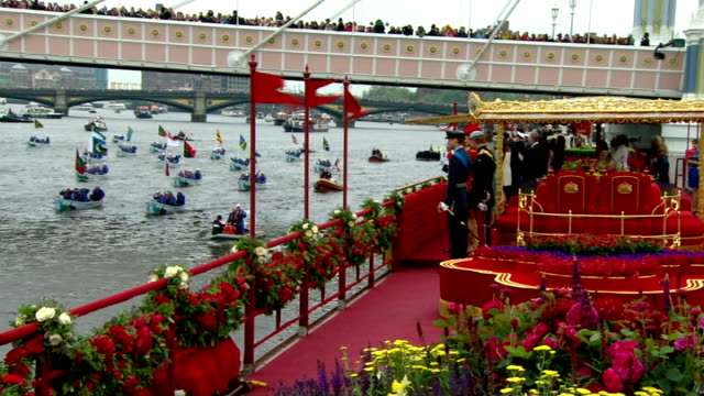 queen's diamond jubilee: highlights of the celebrations; tx 3.6.2012 london: river thames: side view of royal family on royal barge 'the spirit of... - diamond jubilee stock videos & royalty-free footage