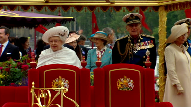 queen's diamond jubilee: prince philip taken to hospital ahead of concert; tx 3.6.2012 england: london: river thames: ext queen elizabeth ii and... - fluss themse stock-videos und b-roll-filmmaterial