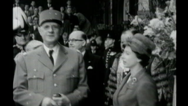 queen's diamond jubilee queen's role as head of the commonwealth s15030703 / tx b/w general de gaulle greeted by queen - charles de gaulle stock videos and b-roll footage
