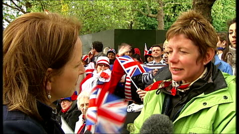 stockvideo's en b-roll-footage met queen's diamond jubilee: southampton cruise ships and fireworks; england: london: ext crowds cheering and waving union jack flags at side of road... - 2012