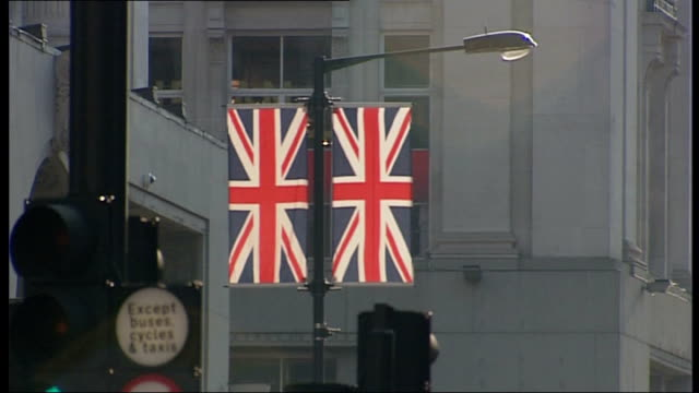 queen's diamond jubilee union jacks abound in london england london ext various of union jack flags hanging in regent street / mannequins in shop... - cufflink stock videos & royalty-free footage